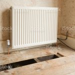 New Radiator Fitted In Old House Showing Pipework And Floorboards Stock Photo Download Image Now Istock