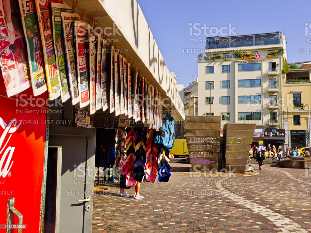 newsstand with newspapers in monastiraki square and residential buildings stock photo download image now istock