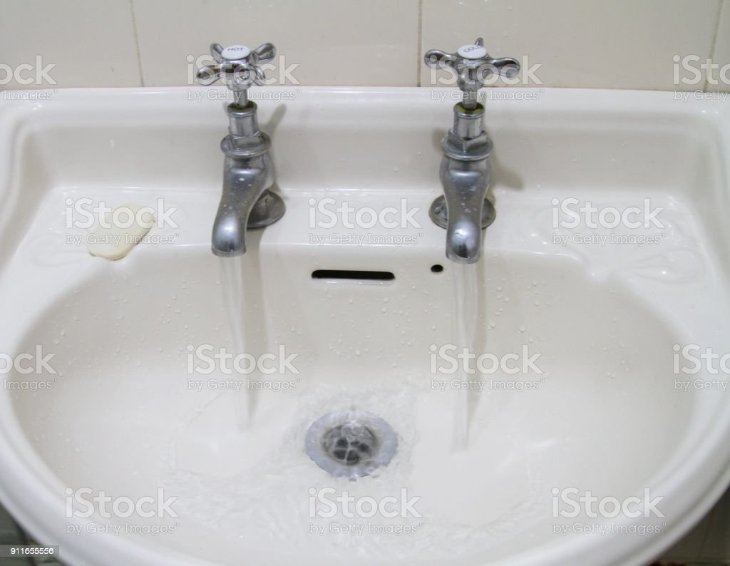 old fashioned taps and sink with running water stock photo download image now istock