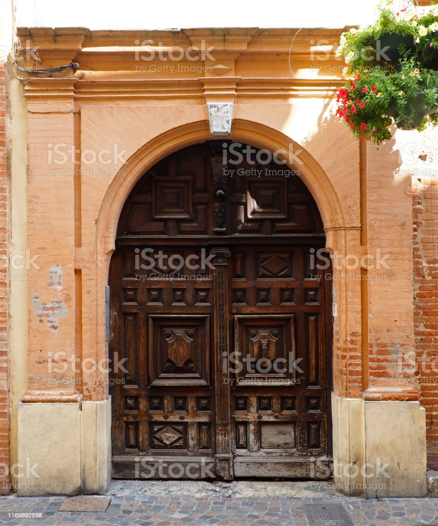 https www istockphoto com photo old solid wood door of a house of montauban large and old french town on the banks gm1169892558 323568960