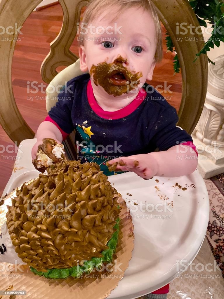 One Year Old Boy Enjoying His First Birthday Cake Stock Photo Download Image Now Istock