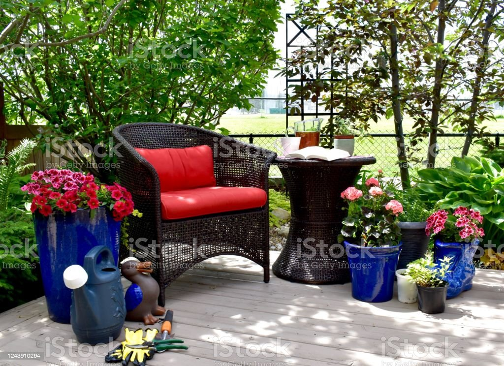 outdoor patio seating for relaxing in beautifully landscaped small space backyard on summer afternoon stock photo download image now istock