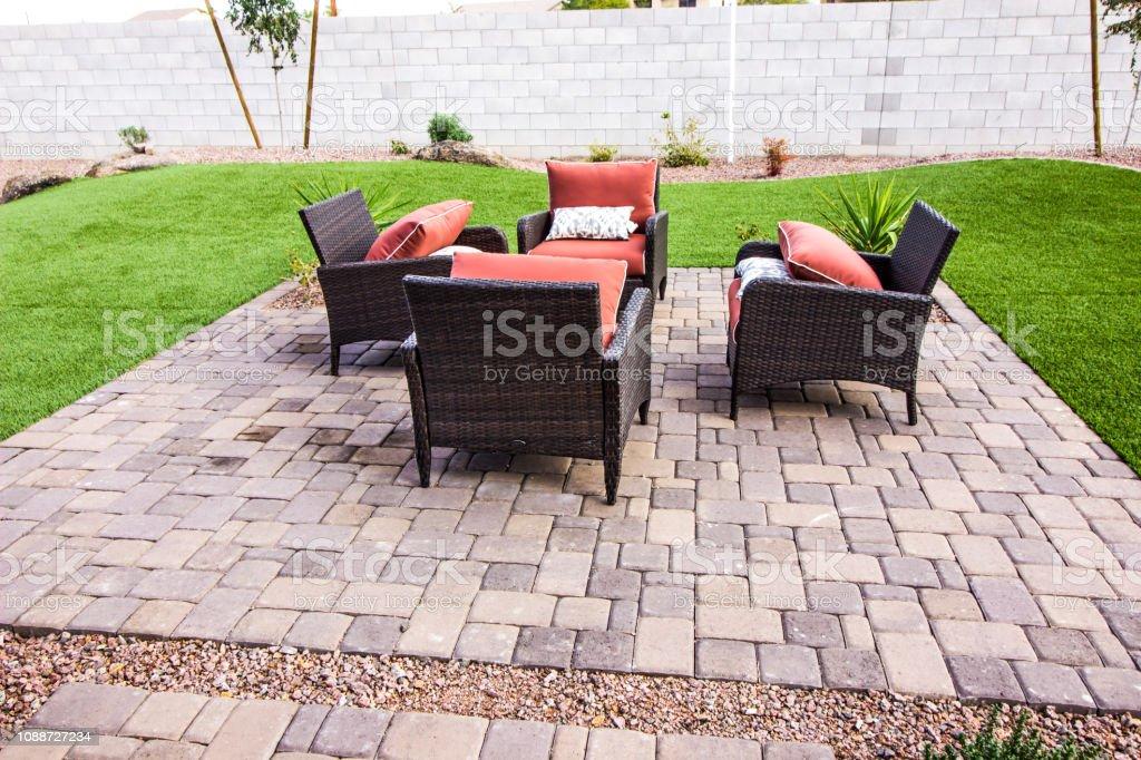 patio de adoquines al aire libre con cuatro sillas de mimbre foto de stock y mas banco de imagenes de aire libre istock