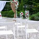 Outdoor Wedding Decorations Arch Decorated With Red And White Flowers Chairs Lanterns Stock Photo Download Image Now Istock