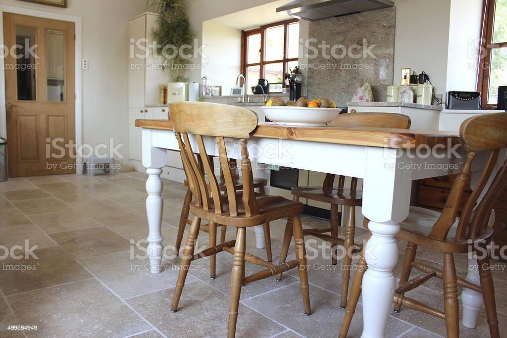 https www istockphoto com photo painted pine table and chairs kitchen diner travertine tile floor gm499584949 42667468