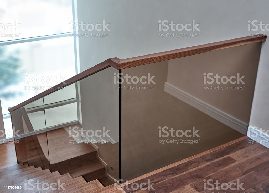 Part Of Wooden Steps With Glass Railings Walnut Staircase Stock | Wood And Glass Banister | Grey | Before And After | Rustic Glass Interior | Concrete Stairs Wooden Glass | Acrylic