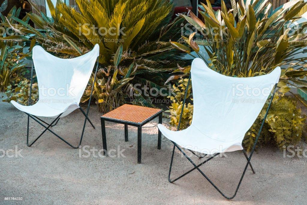 https www istockphoto com photo patio chairs gm861764232 142720191