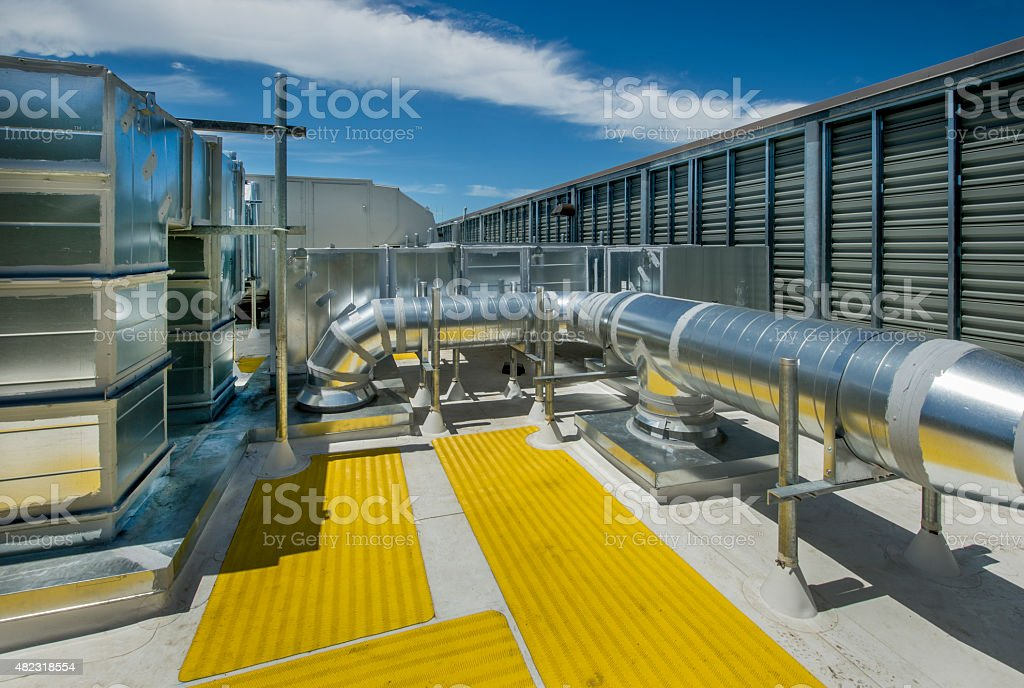 https www istockphoto com photo rooftp hvac system with exhaust fan and condenser gm482318554 70222599