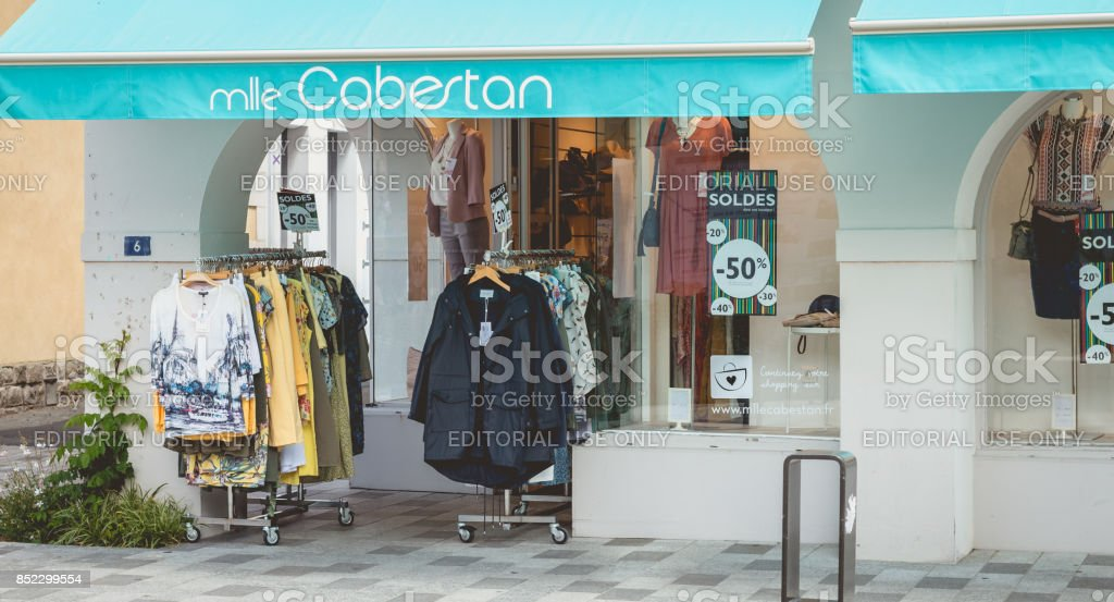 https www istockphoto com photo showcase of a clothing store during the summer soldes 2017 gm852299554 140217343