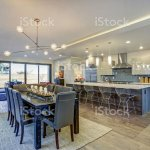 Sleek Modern Kitchen Design With A Long Center Island Stock Photo Download Image Now Istock
