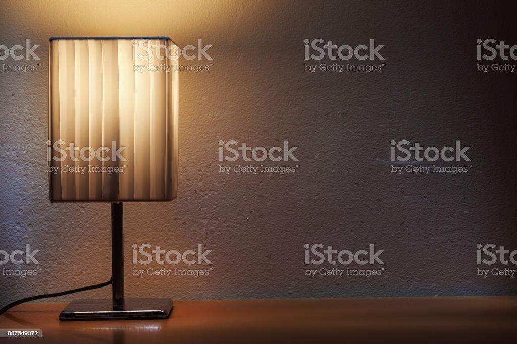https www istockphoto com photo small decorative table lamp gm887549372 246315487