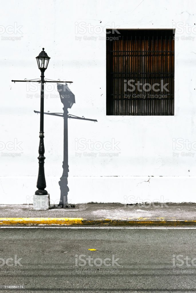 https www istockphoto com photo street light in front of a white wall with one dark window gm1140564174 305262918