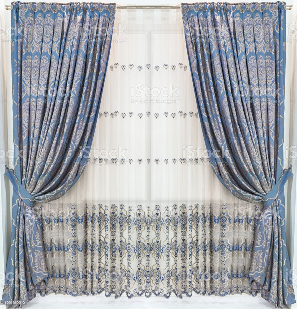 https www istockphoto com photo stylish design of window and doorways hidden tab top curtain panels with ornament gm1061610510 283793226