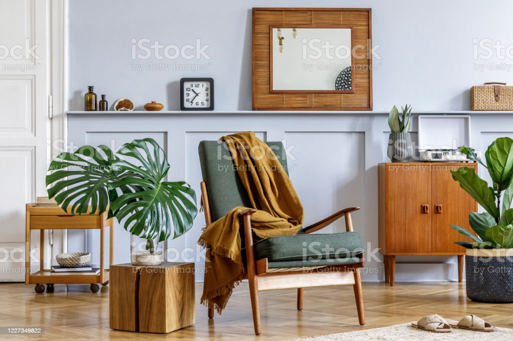 stylish interior of living room with design armchair vintage commode mirror shelf tropical leaves coffee table plants decoration carpet and persnoal accessories in home decor stock photo download image now istock