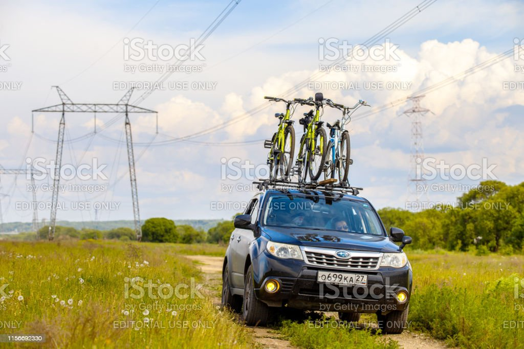 subaru forester with three bicycles on roof rack stock photo download image now istock