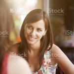 Two Girls Talking In Cafe Stock Photo Download Image Now Istock