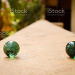 Two Glass Green Marble Ball With A Nice Shadow And Good Lighting With Blur Green Background Stock Photo Download Image Now Istock