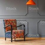 Lebendige Orange Deckenleuchte Und Einem Bequemen Sessel Mit Einem Bunten Bohomuster In Einem Grauen Wohnzimmer Interieur Mit Platz Fur Einen Tisch Echtes Foto Stockfoto Und Mehr Bilder Von Behaglich Istock