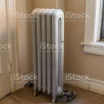Vintage Radiator Beside A Window In An Old American Apartment Building Stock Photo Download Image Now Istock