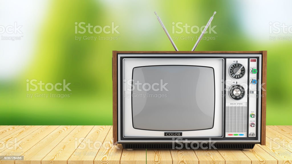 vintage tv box on wooden table on background of nature stock photo download image now istock