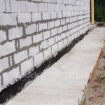 Waterproofing And Insulation Unfinished House Foundation Wall Waterproofing House Foundation With Bitumen Membrane Stock Photo Download Image Now Istock