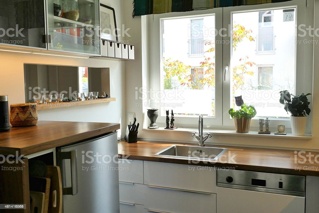 https www istockphoto com photo white domestic kitchen with sink in front of a window gm481416568 69351007