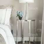 White Shade Reading Lamp And Blue Rose On Glass Top Stainless Steel Frame Bedside Table Next To Bed Stock Photo Download Image Now Istock