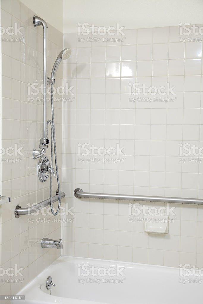 https www istockphoto com photo white tile bathroom tub shower with grab bars for handicapped gm182414212 11865775