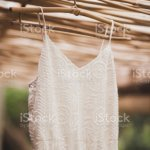 White Wedding Dress Hanging In Tropical Bamboo House In Morning Bride Getting Ready Stock Photo Download Image Now Istock