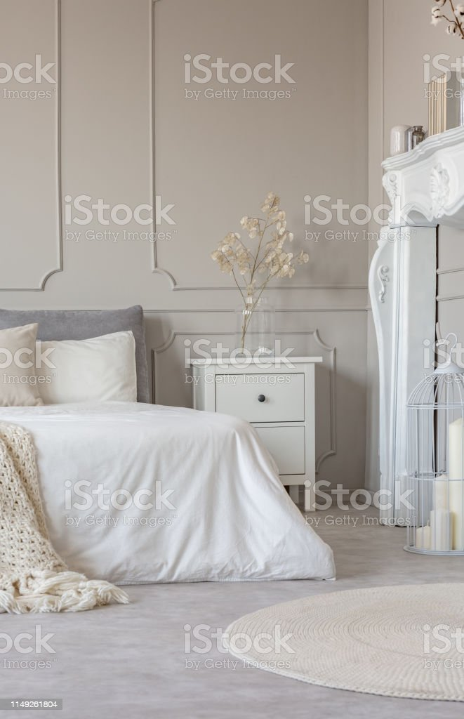 White Wooden Fireplace Portal In Beautiful Bedroom Interior With White Sheets On King Size Bed Stock Photo Download Image Now Istock