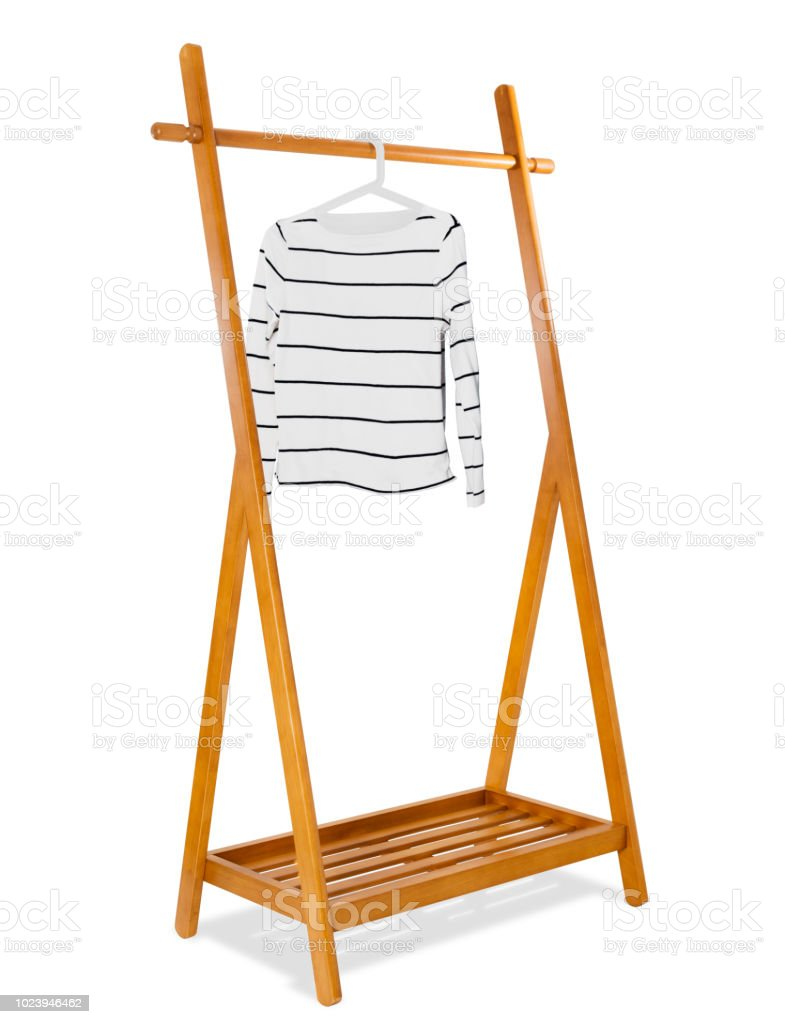 https www istockphoto com photo wooden clothes rack with white fashion woman sweater on clothes hanger fashion and gm1023946462 274782070