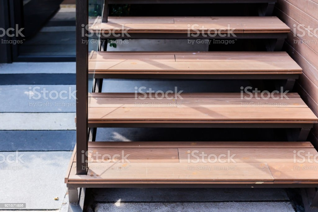 Wooden Step Stair Outdoor Location With Steel Railing Stock Photo   Outdoor Wooden Handrails For Steps   Stair Treads   Deck Stairs   Wrought Iron   Staircase   Brick