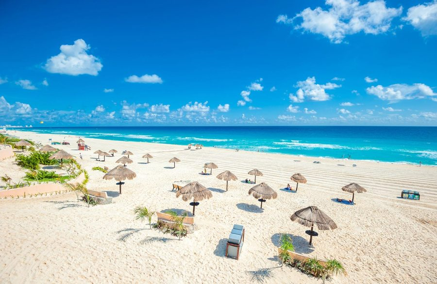 United Cheap Flights to Cancun   Flight Deals to  CUN    United Airlines Beach umbrellas and chairs line the sand in Cancun