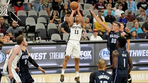 Magic hand Spurs 125-89 loss in preseason opener
