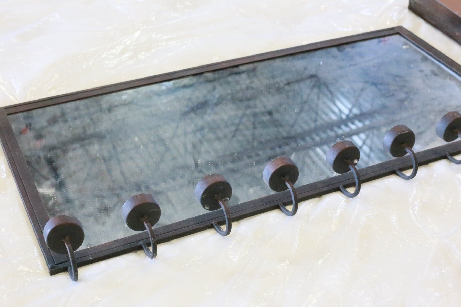 METAL FRAMED WALL MIRROR WITH DECORATIVE TEALIGHT HOLDERS
