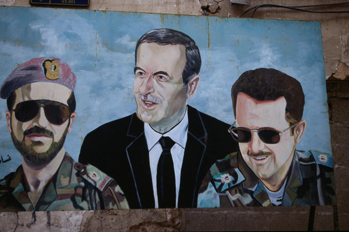 The many faces of the president, Hafez al-Assad, and his sons: a mural on a wall