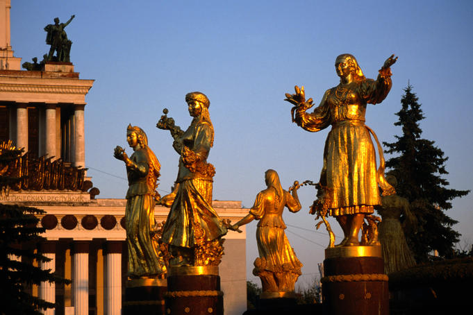 Golden statues of women from various former Soviet Republics surround fountain at All-Russian Exhibition Centre.