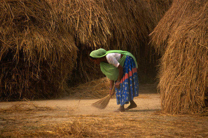 Image result for african woman sweeping
