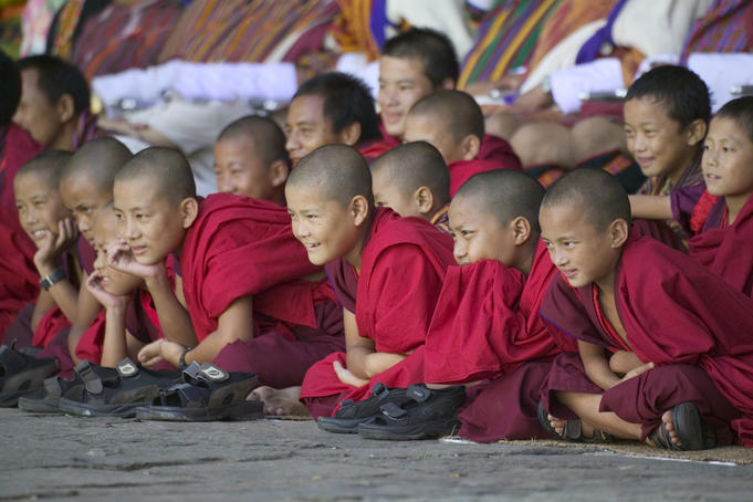 Young monks watching Tshechu Festival celebration at Wangdue Phodrang Dzong.