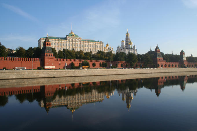 Great Kremlin Palace reflected in Moskva River.