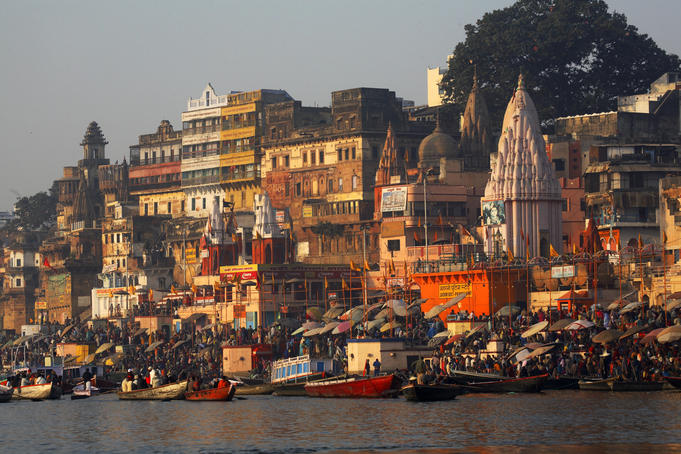 India Varanasi main ghat steps down to river Ganges with iconic pilgrims and bathers at river Ganges Jan 2007