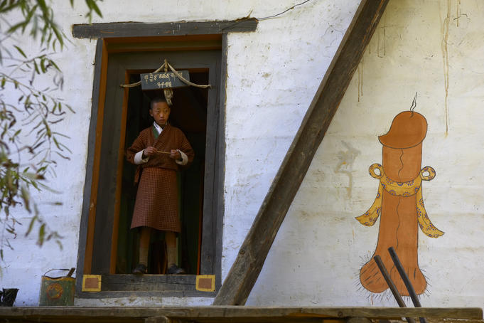 Phallus painted on village house wall for increasing fertility, Paro Valley.