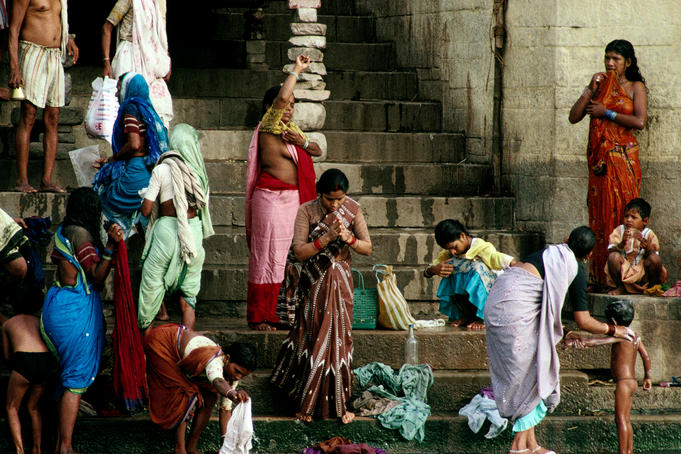 Washing clothes, children and praying on the ghats by the River Ganges - Varanasi, Uttar Pradesh