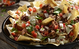 NEW Brisket Nachos are slowly smoked beef brisket, creamy queso and roasted jalapeños.