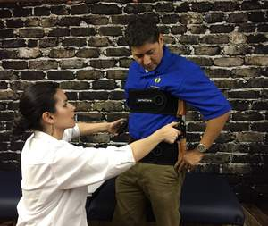 Spine Care Center Specialist Helping Patient Relieve Back Pain with a $299 VerteCore Lift