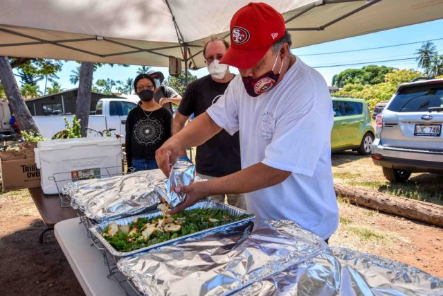Kenton Detweiler serves food to homeless.