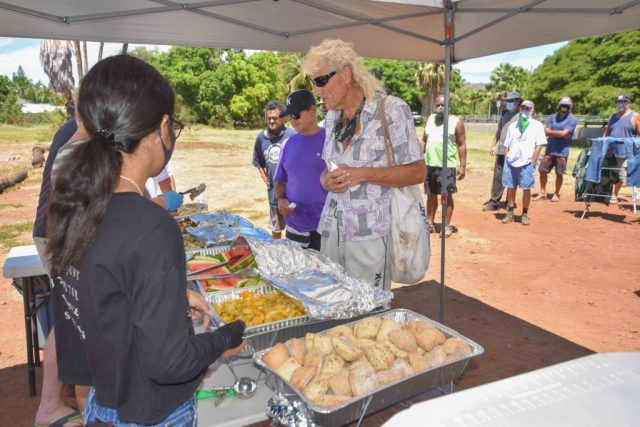 Homeless receive hot meal from volunteers at Lahaina Baptist Church.