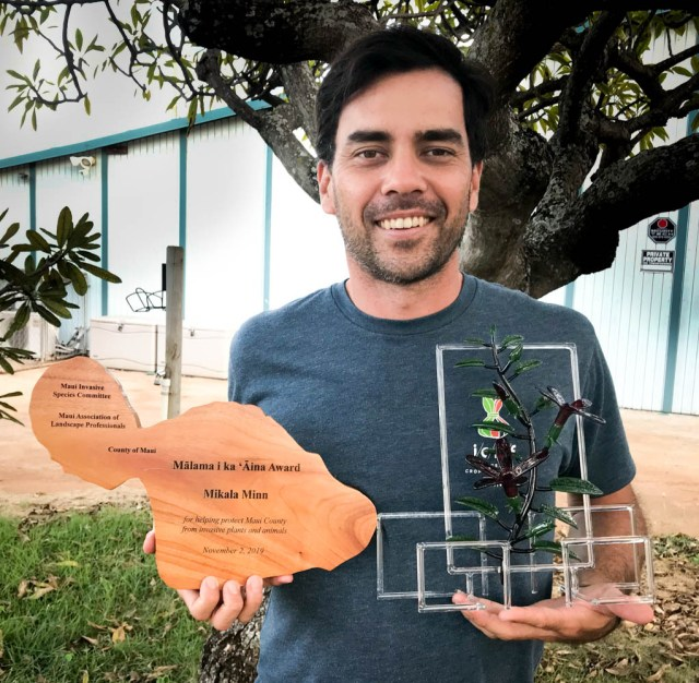 Mikiala Minn holds Maui Invasive Species Committee Award