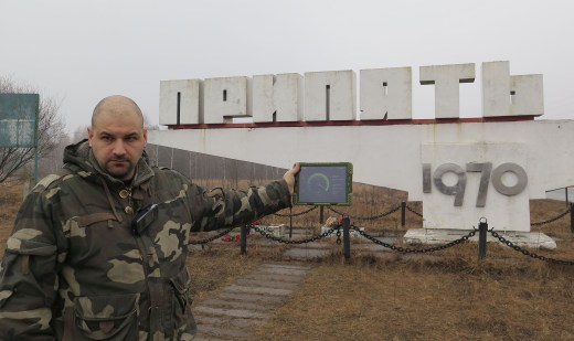 Alexandr Sirota holds up a Geiger counter at the monument celebrating the cornerstone ceremony of Pripyat at its founding in 1970. Once seen as a shining example of the future of the Soviet Union, the town was abandoned after the Chernobyl accident. // Claudia Himmelreich / McClatchy