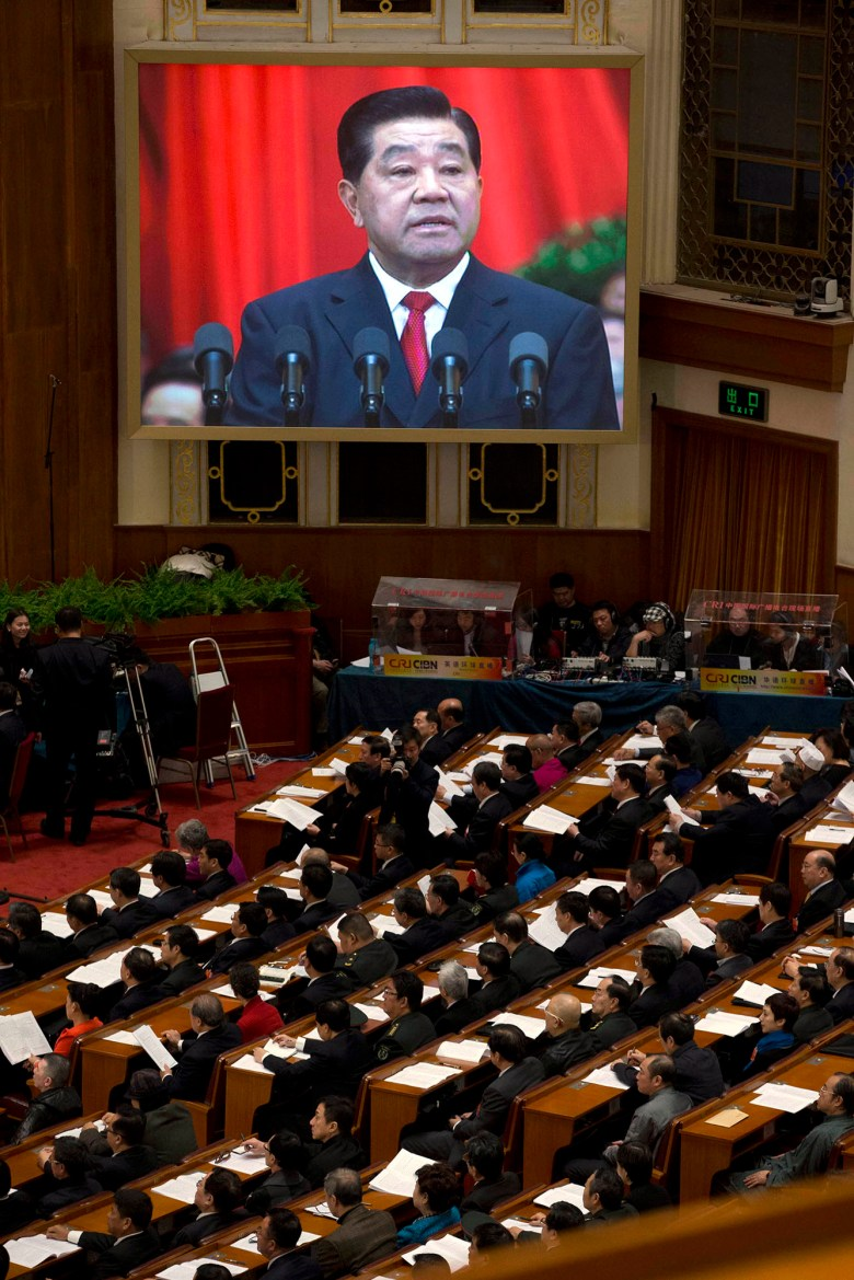 Jia Qinglin, Chairman of the Chinese People's Political Consultative Conference (CPPCC), is displayed on a screen as he delivers a speech at the opening session of the Chinese People's Political Consultative Conference in Beijing's Great Hall of the People on March 3, 2013. // Ng Han Guan / AP